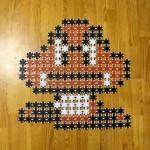 Personajes de Mario armados con fichas de póker